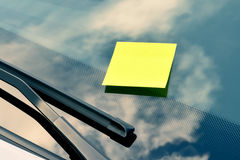 Yellow Sticky Note on a Windshield Stock Photography