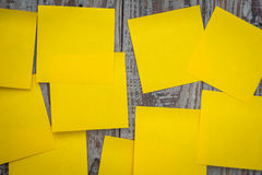 Yellow sticky note. On wooden board Stock Photo