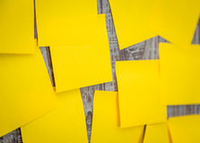 Yellow sticky note. On wooden board Stock Photos