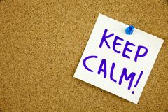 A yellow sticky note writing, caption, inscription Keep calm reminder or advice on a sticky note in black ext on a royalty free stock image