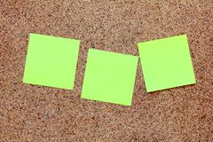 Yellow sticky notes on a cork board Royalty Free Stock Photos