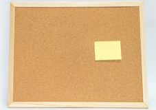 Yellow sticky notes on cork bulletin board. With copy space for design Stock Images