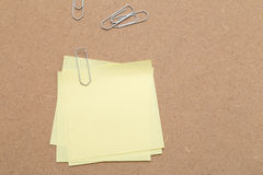 Yellow Sticky Notes and paper clips Stock Photo