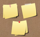 Yellow sticky notes on sand board. Stock Photos