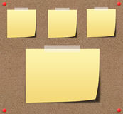 Yellow sticky notes on sand board. Stock Photo