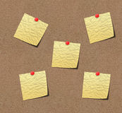 Yellow sticky notes on sand board. Royalty Free Stock Image