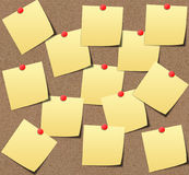 Yellow sticky notes on sand board. Stock Images