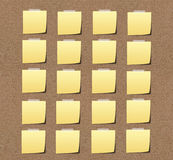 Yellow sticky notes on sand board. Royalty Free Stock Images