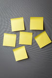 Yellow sticky notes on wall Stock Photos