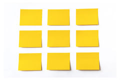 Yellow sticky notes. On white background Stock Photos