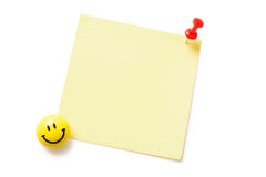 Yellow sticky paper isolated. Yellow sticky paper with pushpin isolated on white background Royalty Free Stock Images