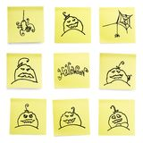 Yellow sticky papers set with Halloween doodles. Stock Image