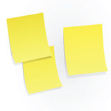 Yellow sticky papers on white Stock Photography