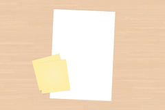 Yellow Sticky Post It and White Paper Stock Images