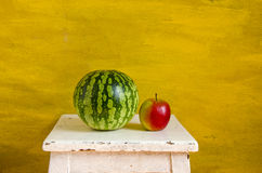 Yellow still-life with watermelon Stock Photos