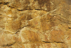Yellow stone background texture cliff rock natural. Natural rock yellow stone background texture grunge Royalty Free Stock Photography