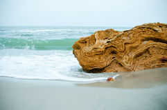 Yellow stone on the beach Royalty Free Stock Photography