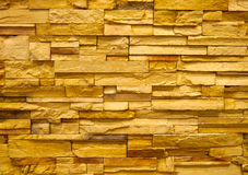 Yellow stone block wall Stock Photo