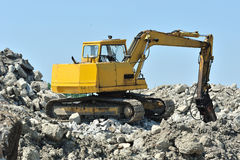 Yellow stone breaker excavator on site Royalty Free Stock Images