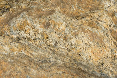 Yellow stone texture, granite surface. Colored rock pattern background. Royalty Free Stock Photography