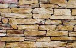 Yellow stone wall Stock Photo