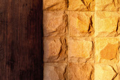 Yellow stone wall with a oak decor Royalty Free Stock Images