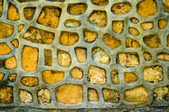 Yellow stone wall texture Stock Photos