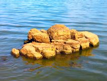 Yellow stones in water Royalty Free Stock Photography