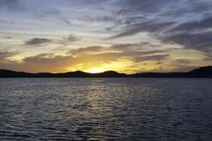 Yellow stratocumulus cloudy coastal Sunrise Seascape. Australia royalty free stock photo