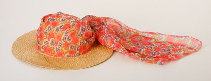 Yellow straw hat with decorative silk scarf Royalty Free Stock Photo