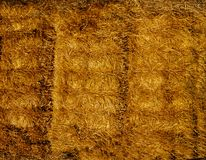 Yellow straw is pressed into bales .Texture or background. Straw was pressed into large bales lying on top of each other.Texture or background stock photos