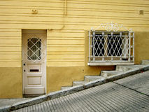 Yellow Street. Door and window in a yellow home near Parc Güell in Barcelona, Spain Royalty Free Stock Photo