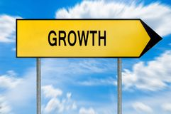 Yellow street concept growth sign. Isolated on sky background close royalty free stock image