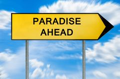 Yellow street concept paradise sign. Isolated on sky background close royalty free stock photography