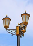 Yellow street lamp against sky Stock Photography