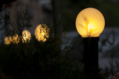 Yellow street lights in dark Stock Images