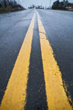 Yellow street lines Royalty Free Stock Images