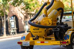 A yellow street power vacuum in Santa Monica, LA royalty free stock photography