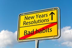 Yellow street sign with New Years resolutions ahead leaving bad Royalty Free Stock Photography