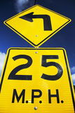 Yellow street sign saying 25 Miles Per House Stock Photos