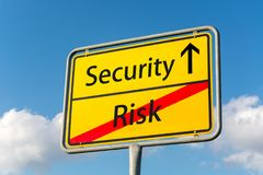 Yellow street sign with Security ahead leaving Risk behind Royalty Free Stock Image