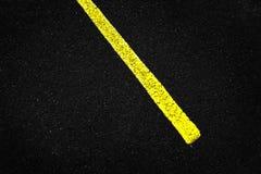 Yellow Stripe on Asphalt Road Stock Photos