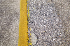 Yellow stripe. On a concrete surface stock photography