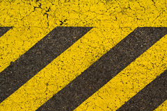 Yellow striped road markings on black asphalt. Royalty Free Stock Photos
