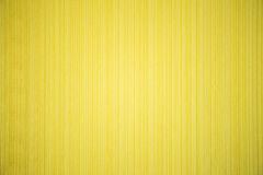 Yellow striped textured wallpaper Royalty Free Stock Photos