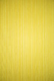 Yellow striped textured wallpaper Stock Photo