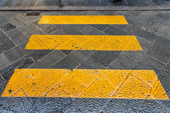 Yellow stripes crosswalk across the street. Travel to Italy - yellow stripes crosswalk across the street in Florence city Stock Images