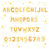 Yellow stripes and spotted alphabet and figures Stock Images