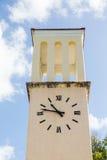 Yellow Stucco Clock Tower Royalty Free Stock Photos