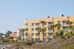 Yellow Stucco Condo Beyond Tropical Beach Royalty Free Stock Photography